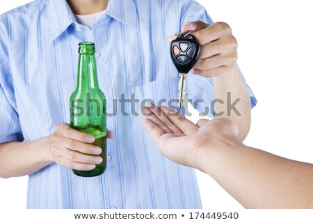 male driver hands holding beer bottle and car key Stock photo © dolgachov