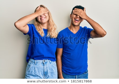 portrait of a surprised multiethnic couple standing stock photo © deandrobot