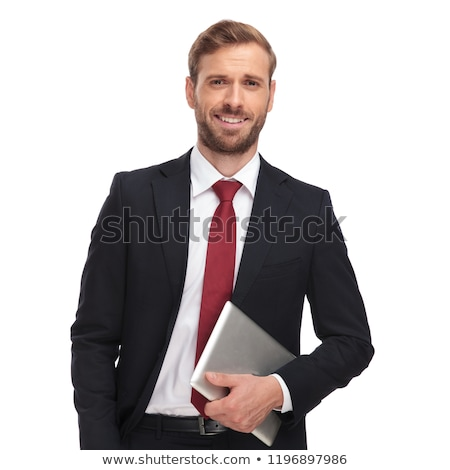 portrait of handsome smart casual man in navy suit standing Stock photo © feedough