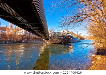 Mur river and Murinsel island in Graz under the bridge view stock photo © xbrchx
