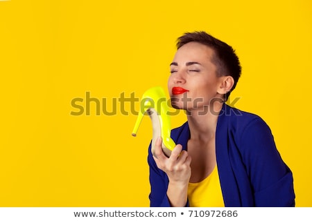 Woman Holding Stinky High Heels Stock photo © AndreyPopov