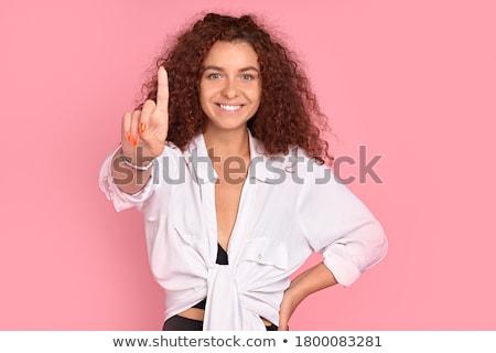 Boldog izgatott fiatal nő pózol izolált rózsaszín Stock fotó © deandrobot