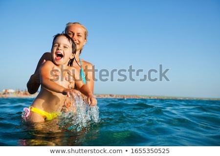risonho · menina · ar · colchão · jovem · piscina - foto stock © dashapetrenko