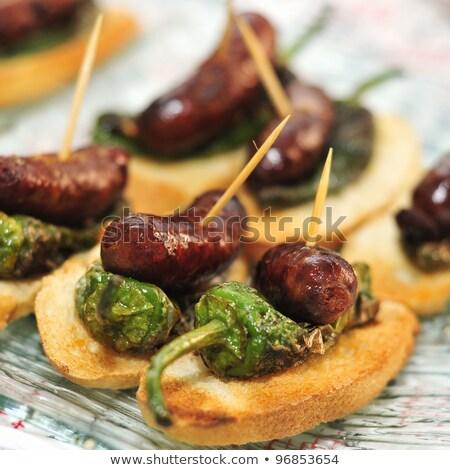 spanyol · chorizo · szeletek · piros · fűszeres · füstölt - stock fotó © alex9500