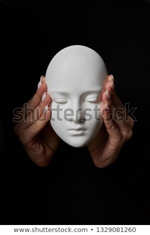 Female hands close ears of plaster mask face on a black background. Hear no evil. Concept three wise Stock photo © artjazz