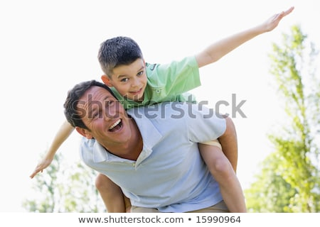 Father and son playing piggy back ride Stock photo © colematt