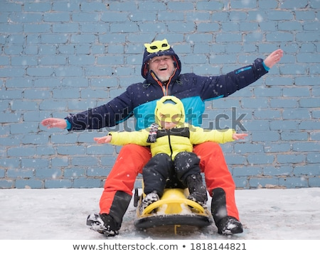 happy kids with sleds waving hands in winter Stock photo © dolgachov