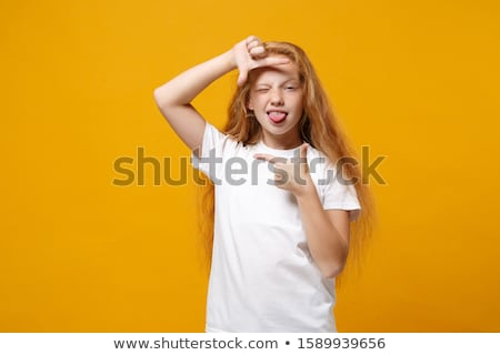 A cute Little Girl with redhead in studio white background Stock photo © Lopolo