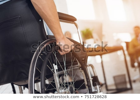 disabled man on wheelchair working in office stock photo © andreypopov