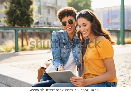 две · женщины · сидят · улице · улыбаясь · счастливым · друзей - Сток-фото © deandrobot