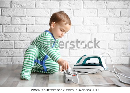 Toddler Playing With Electric Iron Stock photo © AndreyPopov