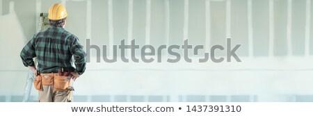 erkek · karşı · alçıpan - stok fotoğraf © feverpitch