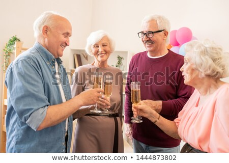 booze party of four senior friends with champagne stock photo © pressmaster