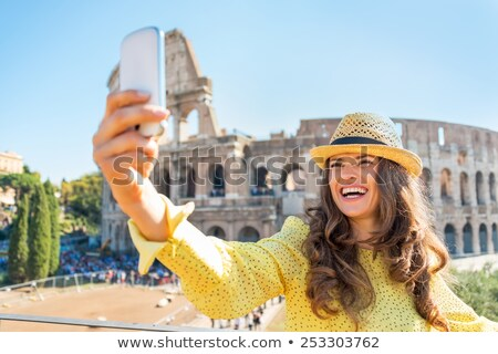 woman taking photo of colosseum stock photo © andreypopov