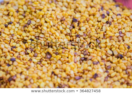 Poppy seeds and pods with extract Stock photo © bdspn