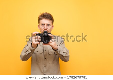 Foto d'archivio: Portrait Of A Funny Nerd Taking A Picture With A Digital Camera