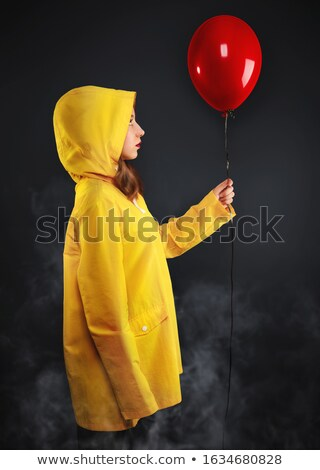 Szomorú kislány pára citromsárga kabát tart Stock fotó © LoopAll