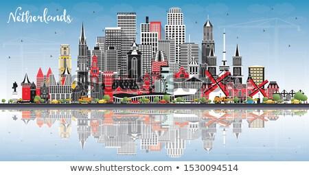 Amsterdam cinza edifícios reflexão blue sky Foto stock © ShustrikS