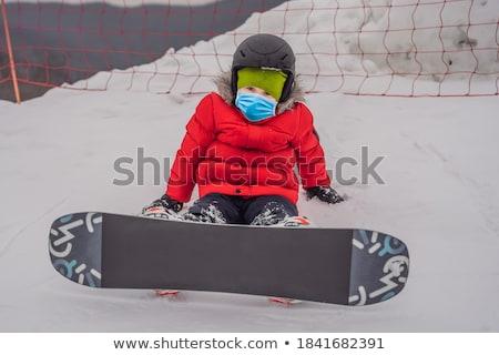 Little cute boy snowboarding. Activities for children in winter. Children's winter sport. Lifestyle Stock photo © galitskaya