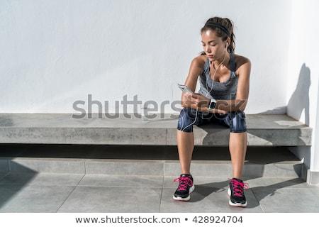 Fitness tracker smartwatch music listening woman Stock photo © Maridav