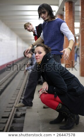 group of young friends on edge of platform of subway station stock photo © paha_l