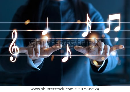 Stock photo: woman with music notes
