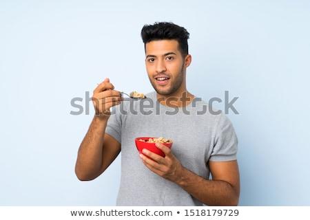 jonge · man · eten · cornflakes · lichaam · model · oranje - stockfoto © photography33