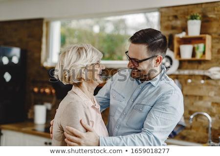 portret · dorosły · kobieta · oglądania · syn · praca · domowa - zdjęcia stock © hasloo