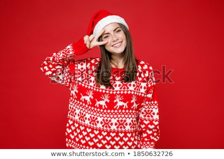 Portrait of beautiful young christmas woman posing wearing santa stock photo © HASLOO