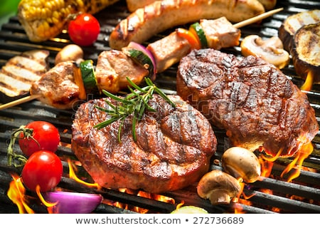 bbq meat with vegetables and greens stock photo © hasloo