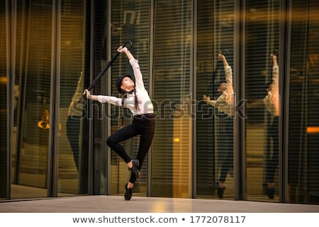 Portrait of young dancing girl with golden body art  Stock photo © HASLOO