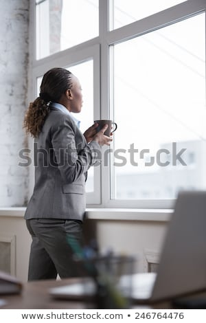 beautiful business woman thinking about something while drinking stock photo © hasloo