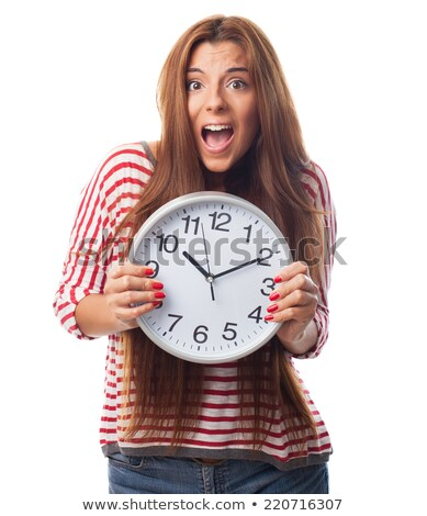Young stresed woman holding a big clock stock photo © scornejor
