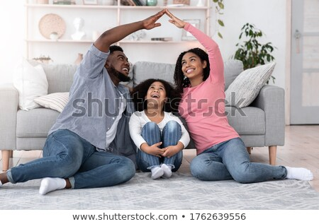 Happy family smiling and joining their heads together stock photo © get4net