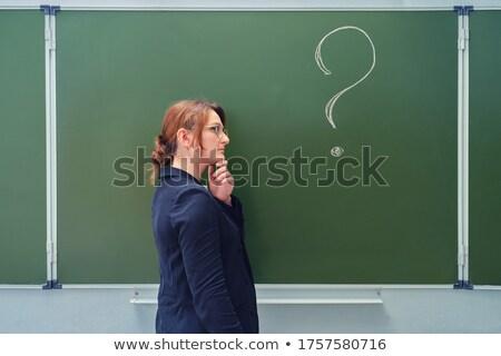Myślenia business woman znaki zapytania napisany czarny tablicy Zdjęcia stock © rufous