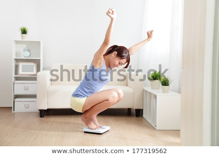 Fitness woman with a scales. stock photo © Kurhan