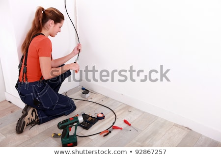 young female electrician wiring a building stock photo © photography33