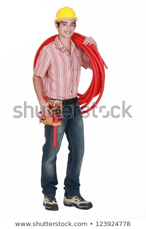 young tradesman carrying corrugated tubing stock photo © photography33
