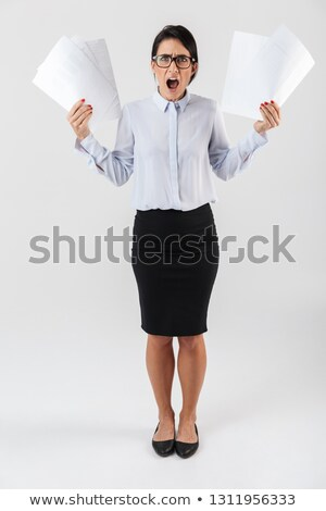 full length portriat of an aged woman carrying business documents stock photo © stockyimages