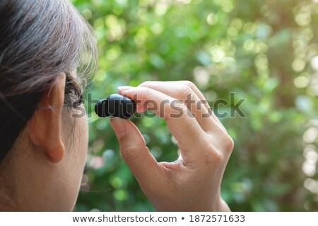recepciós · beszél · headset · ül · asztal · iroda - stock fotó © photography33