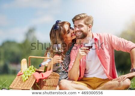Mulher vidro vinho bela mulher vestido preto sofá Foto stock © ssuaphoto