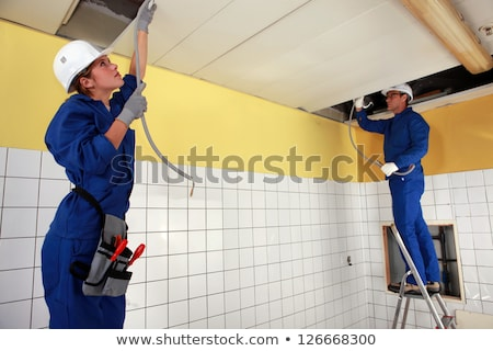 Tradespeople installing a heating system Stock photo © photography33
