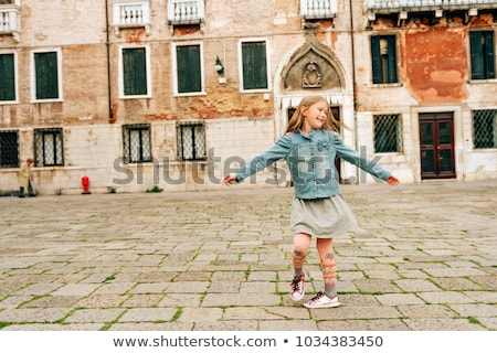 Stock photo: Nice small girl dancing outdoors