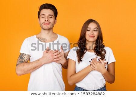 sorridere · bell'uomo · tatuaggi · entrambi · mani - foto d'archivio © stockyimages