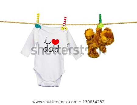 Foto stock: Little Girl Clothes And Toys On A Clothesline