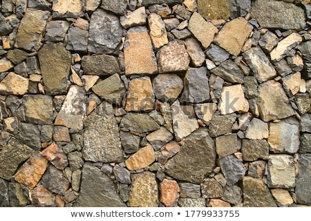 Black lava stone volcanic masonry wall Stock photo © lunamarina