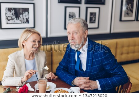 a young man and an old woman at the restaurant posing for the camera stock photo © photography33
