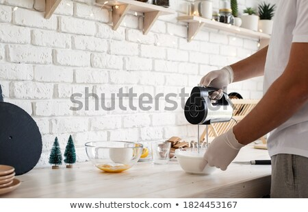 Man with an electric whisk Stock photo © photography33
