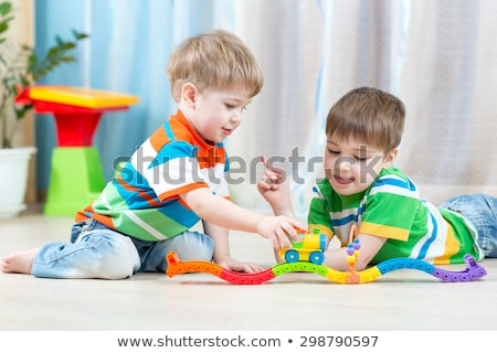 Stock photo: Two happy brothers playing toys