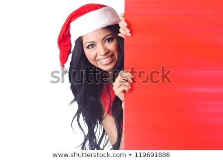santa girl peeking over sign board stock photo © ariwasabi